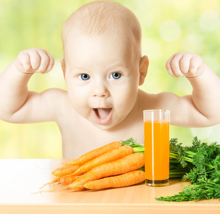 Child And Fresh Carrot Juice Glass. Concept: Healthy Vegetable F